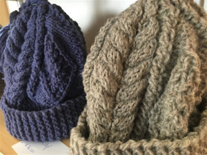 High quality hand knitted hats at the Blue Barrel Gallery.