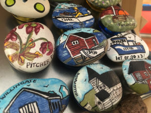 Hand painted rock magnets by Heidi Scarfone here on display at the Blue Barrel Gallery