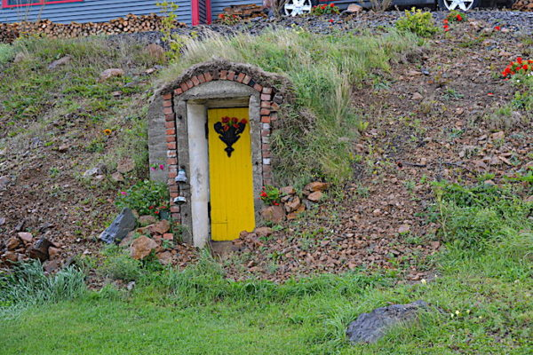 In Durrell, close to the Marine Station, you'll drive by this colourful root cellar with its pretty yellow door.