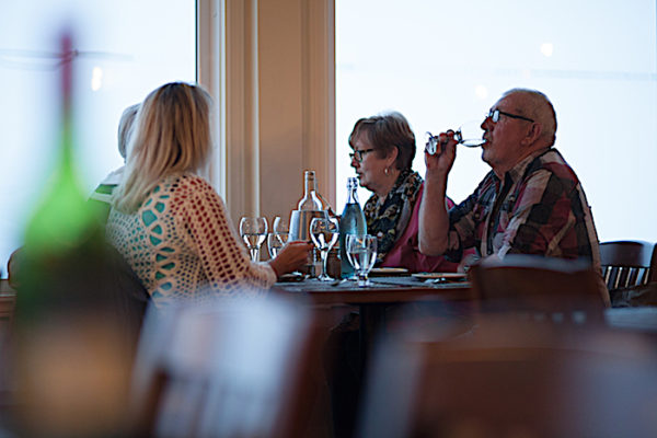 Guests dining at Georgie's Restaurant at the Anchor Inn Hotel