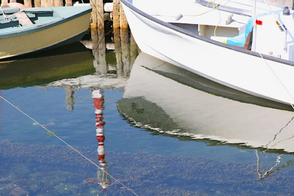 A familiar scene in Twillingate - fishing boat tied to the dock casting their beautiful reflection in the water.