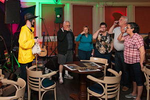 Guests are being screeched in as honorary Newfoundlanders during a screech-in ceremony at Captain's Pub.